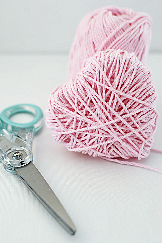 Wrapped heart in pink yarn.