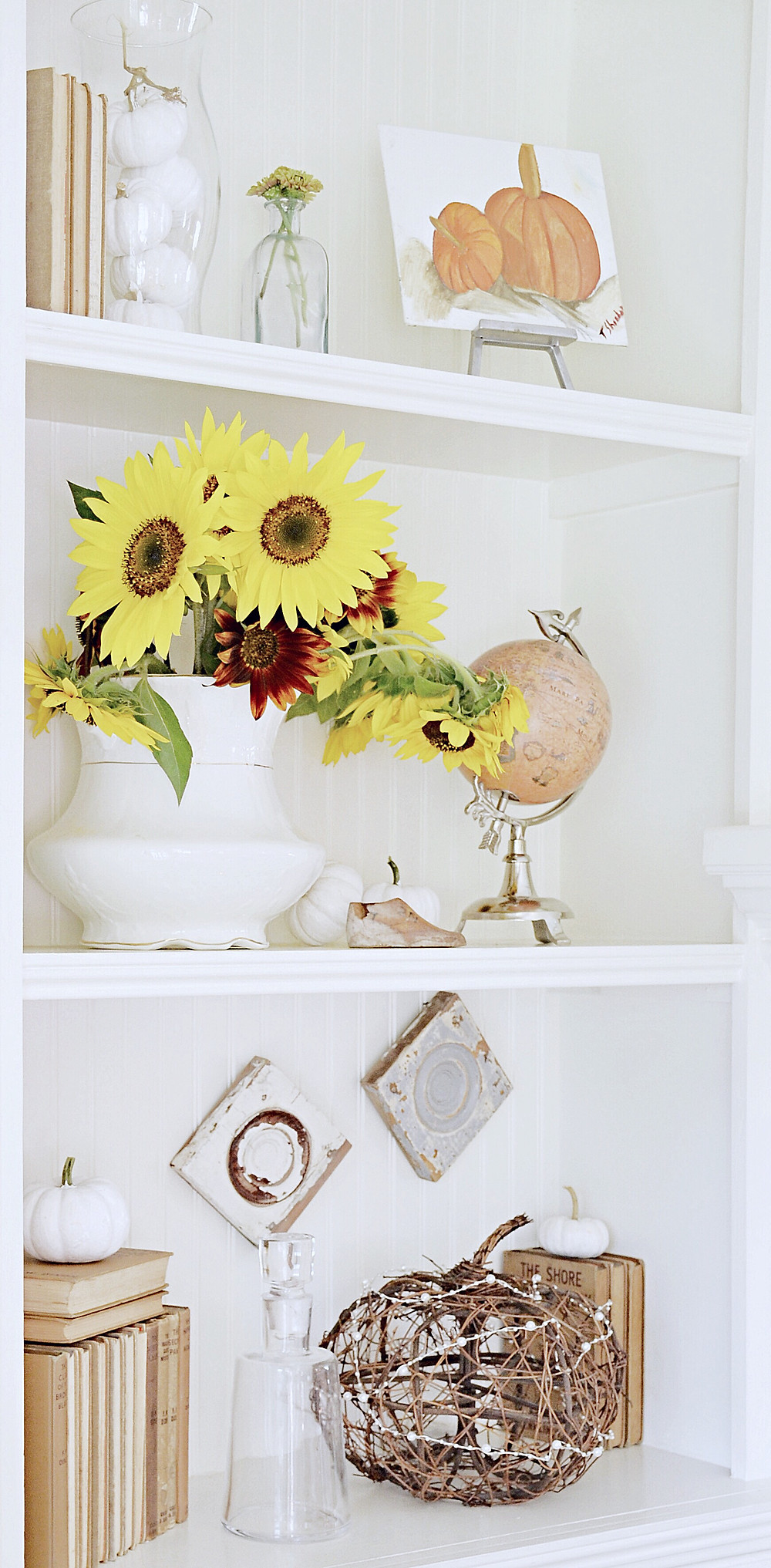 Fall styled built-ins shelves with vintage charm.