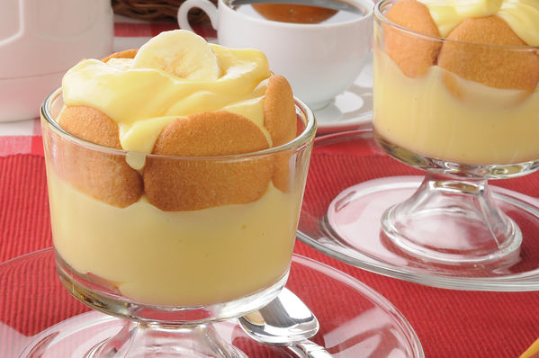 Dessert cups of pudding with vanilla waf