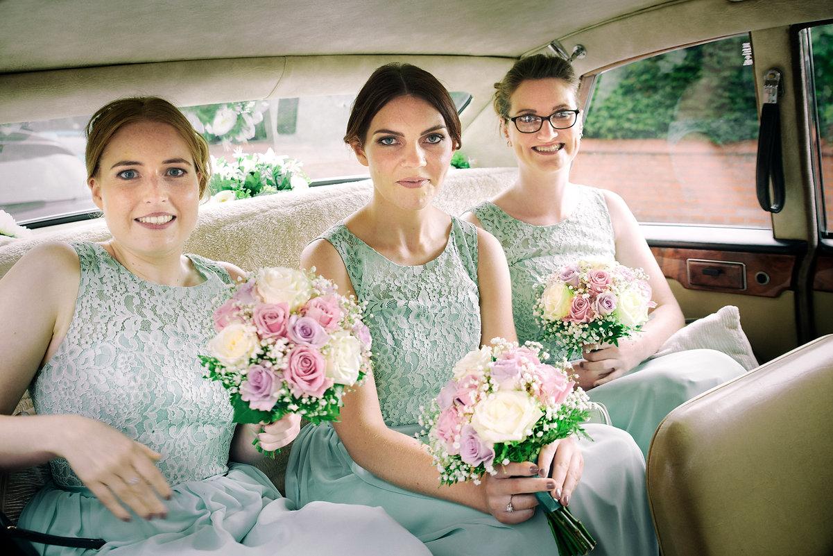 Bridesmaids car smile