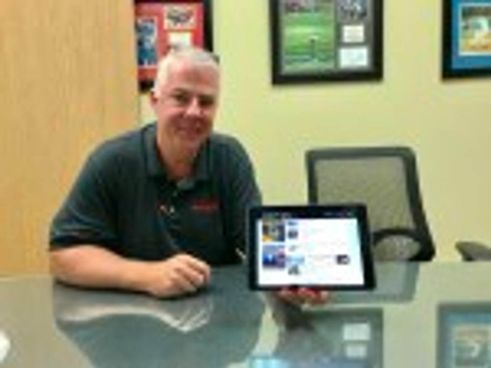 HushMat's Tim McCarthy in the company's conference room. MotionU site on the iPad.