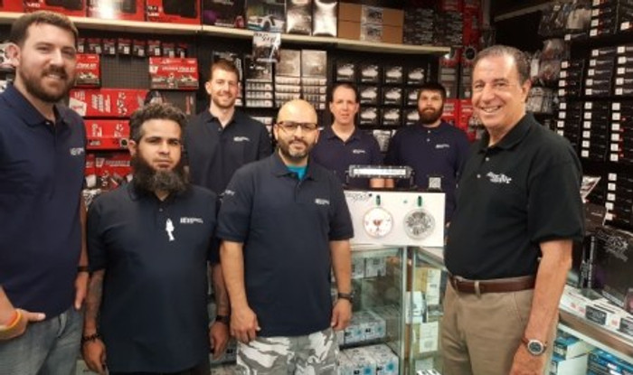 This image includes the IEI Expert 12 Volt Installation & Sales Staff as well as Neil Halprin from NH Sales & Marketing, Manufacturers Representative for Race Sport Lighting. Pictured L-R: Front Row- David Ketcham, Jay Teixera, Juan Rosa, & Neil Halprin. Back Row- Justin Ketcham, Fred Orpen, & Joe Hussey