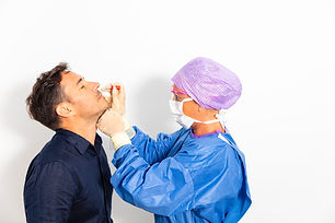A doctor in a protective suit taking a n
