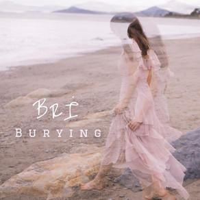 Burying by Brí