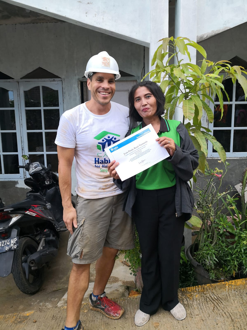 JP with a Batam homeowner during a build trip