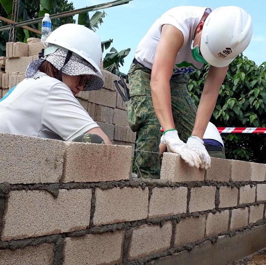 Brick laying to build walls