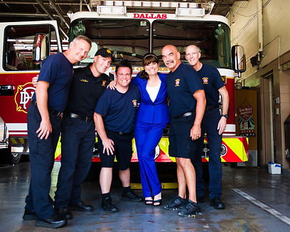 Carolyn With Firefighters.JPG