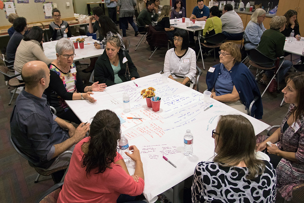 Patrons discuss issues during a community conversation