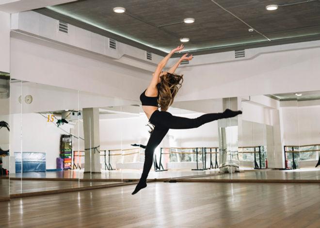 young-female-dancer-practising-dance-stu