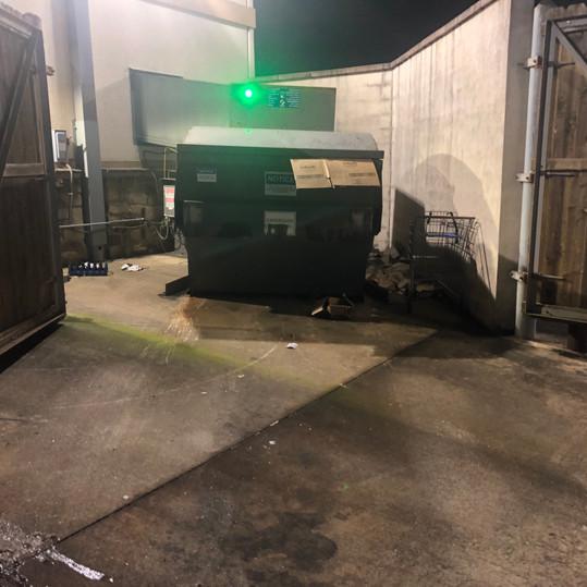 Before dumpster pressure washing