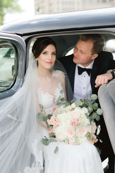 Detroit bride wearing natural makeup sitting in a car with fiance