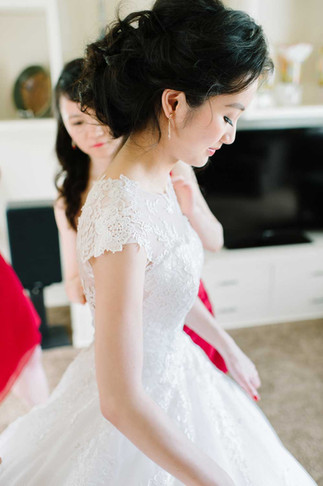 East Asian Ann Arbor bride wearing low loose updo and natural makeup
