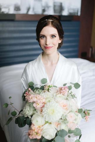 Detroit bride wearing natural makeup holding bouquet