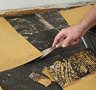 Old yellow asbestos vinyl tiles being removed