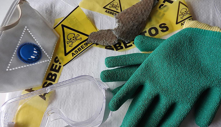 A collection of asbestos signs and glove