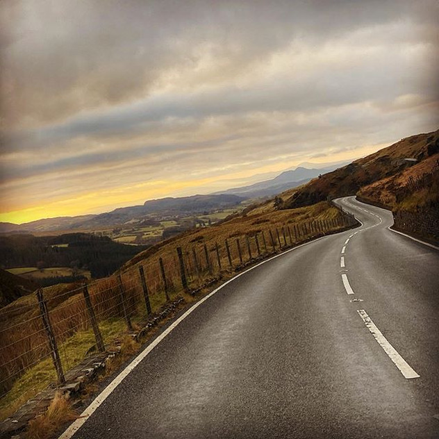 The long road. The mountains. Sunset. Ta