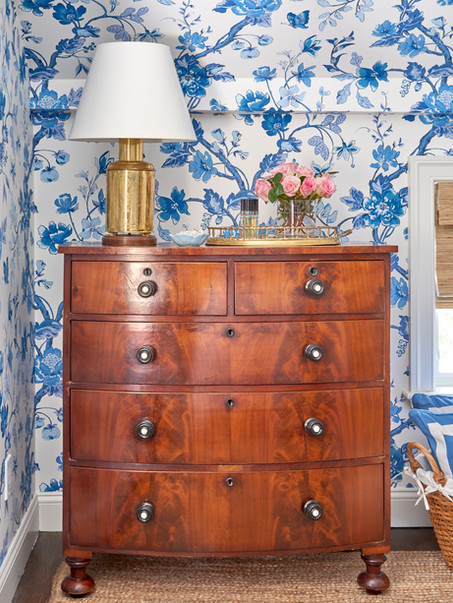 Blue and white wallpaper makes a pretty statment and helps camouflage the uneven walls