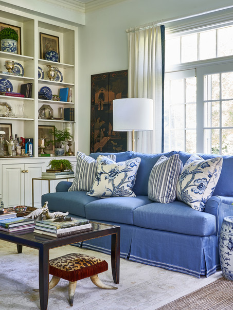 Blue and white living room layered with antique and vintage accessories showcases family heirlooms