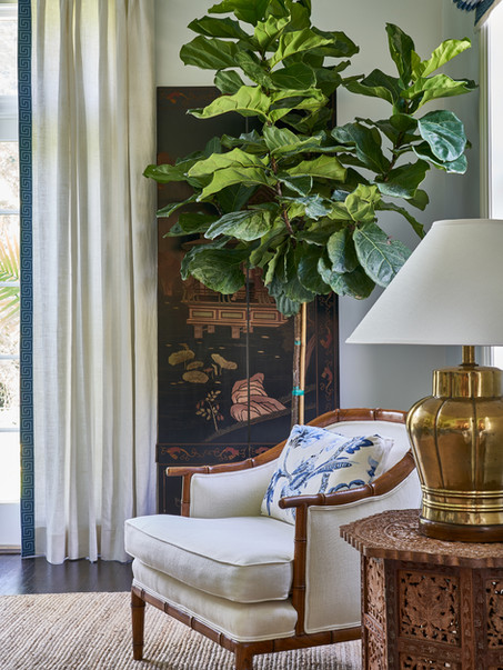 Live trees add a cozy element to a otherwise empty corner