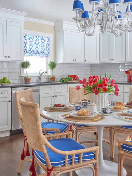 Eat in kitchen with bamboo chairs adds just the right amount fo warmth for a family gathering