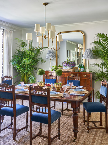 British colonial furnishing imported given new life and mixed with new furnishings and lighting