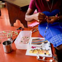 A participant creating a necklace