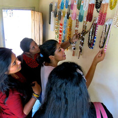 Team visit to an Alumni home jewelry business in 2016