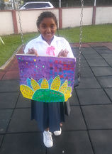 Charis Works Christian Acadmey student artist raises 500.00 TTD for her artwork