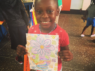 Our youngest student artist showing off her coloring skills