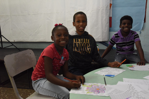 Our youngest artists at the coloring station
