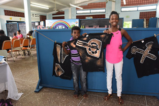Sibling artists showing off their hand-crafted T-shirt