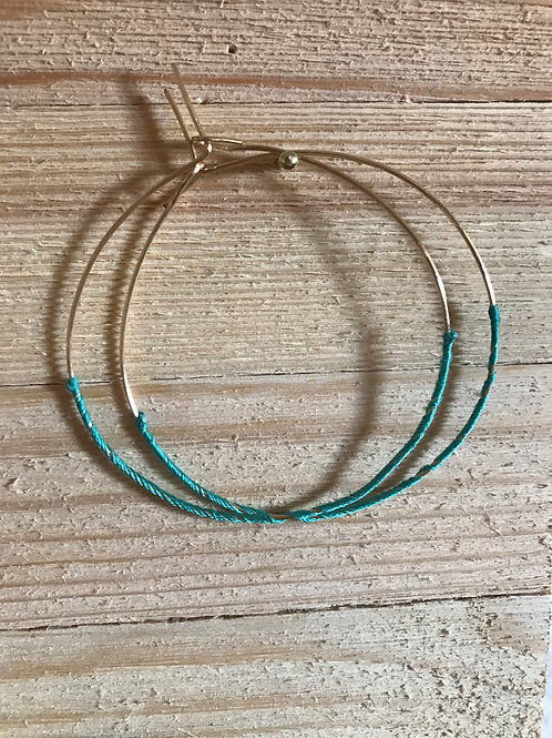 Gold hoop earring with turquoise accent