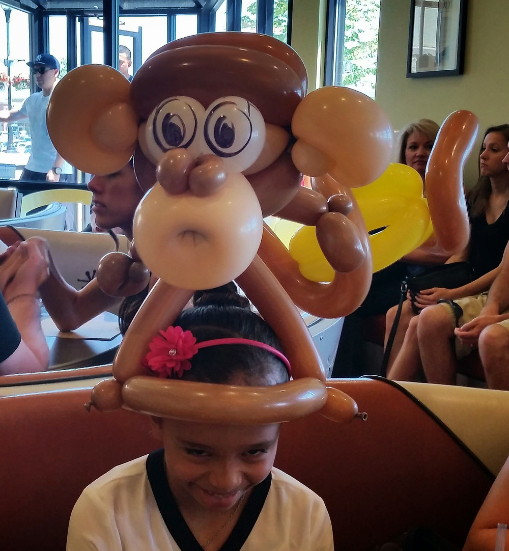 Balloon Animal Monkey at Snooze in Centennial