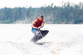 Young athletic man riding kneeboard on a