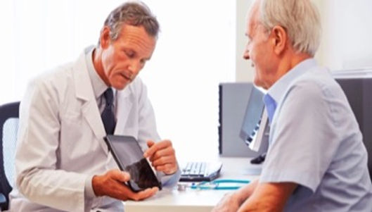 Physician talking with patient about vertebral augmentation recovery and pain relief