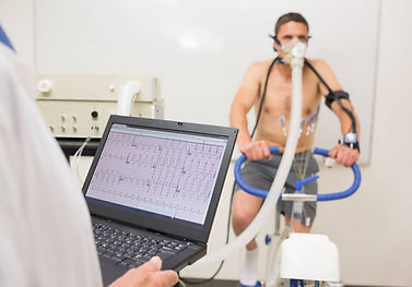 Cardiac stress test patient on exercise bike