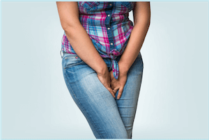 Woman with heavy bleeding caused by fibroids during her period