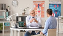 Young man consulting with his Urologist about testicular cancer and fertility after orchiectomy