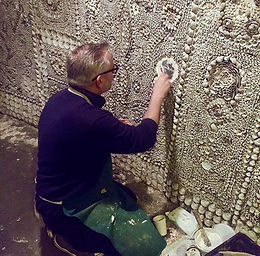 Rob Smith working on a roundel restoration in the Grotto