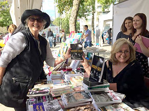 A happy reader posing with author