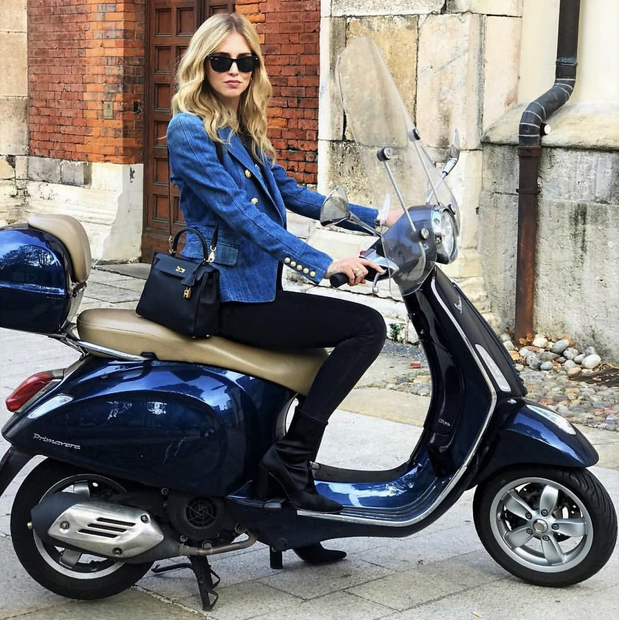 Scooter Girl-The proper with to ride a Vespa.jpg