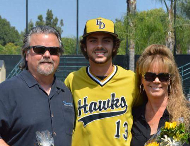 Mark Mahood with his wife and son
