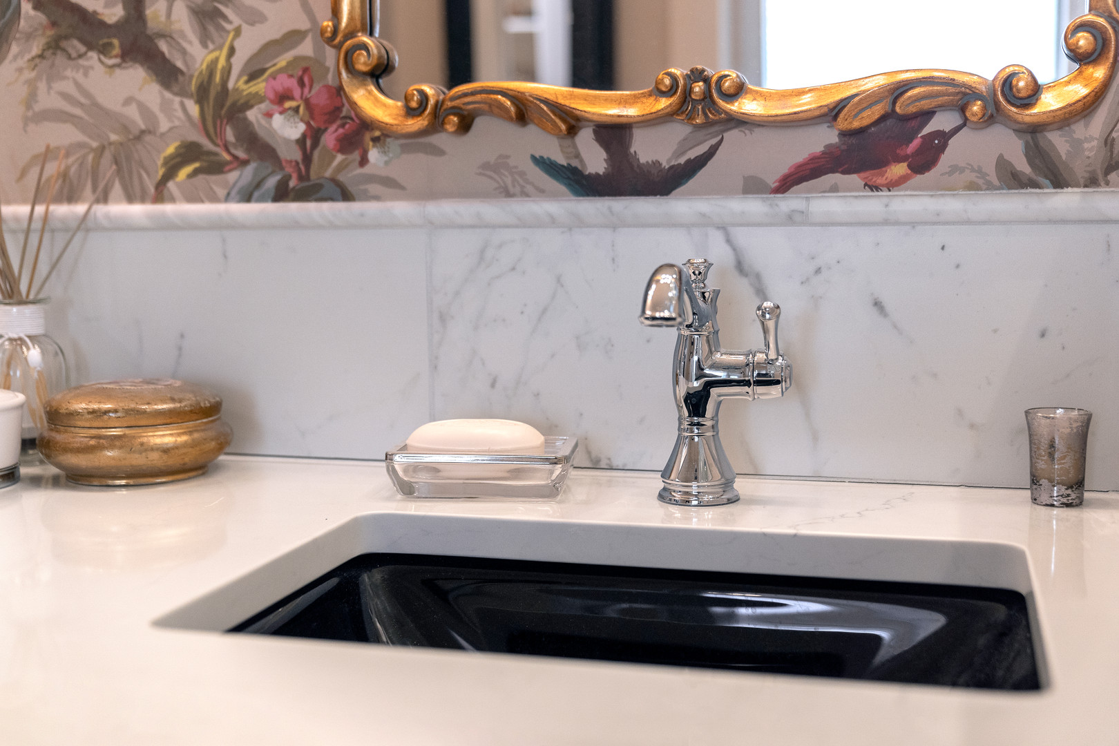 Black sinks with white countertops