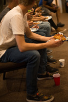 Youth Eating Pizza at Y