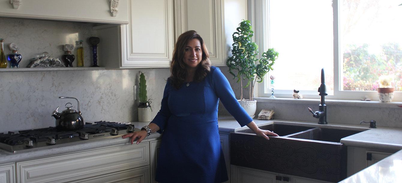 Teri in Kitchen for website.jpg