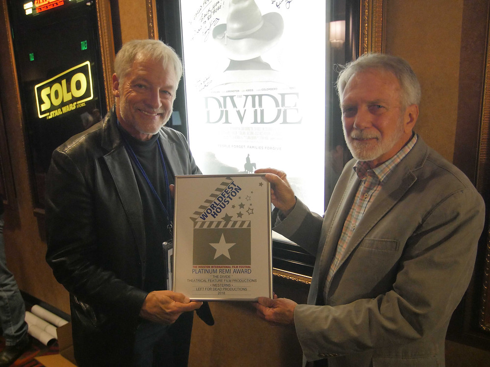 Perry King (Director/Actor) with Russ Rayburn (Cinematographer) hold Platinum Remi award at Houston WorldFest