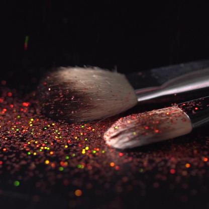 videoblocks-red-sparkles-falling-on-make