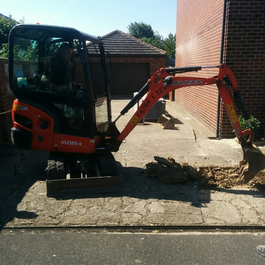 The driveway being dug up.