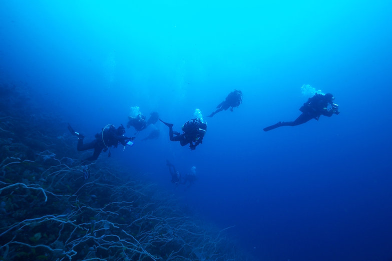 Scuba Divers Deep Sea