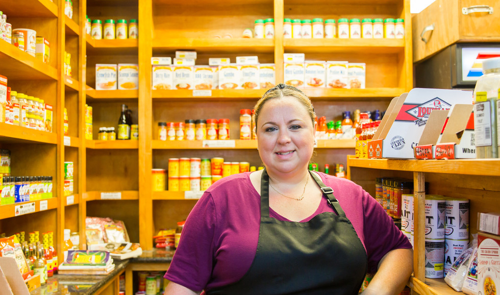 Chef and Owner Katie Cox choosing spices